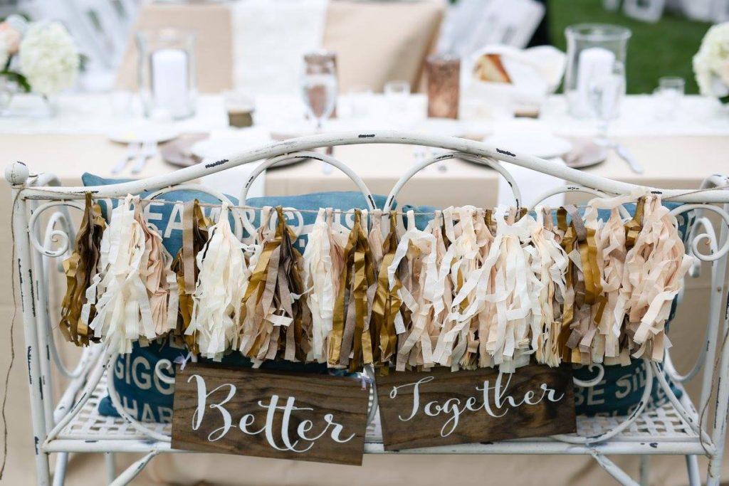 farm wedding bride and groom bench